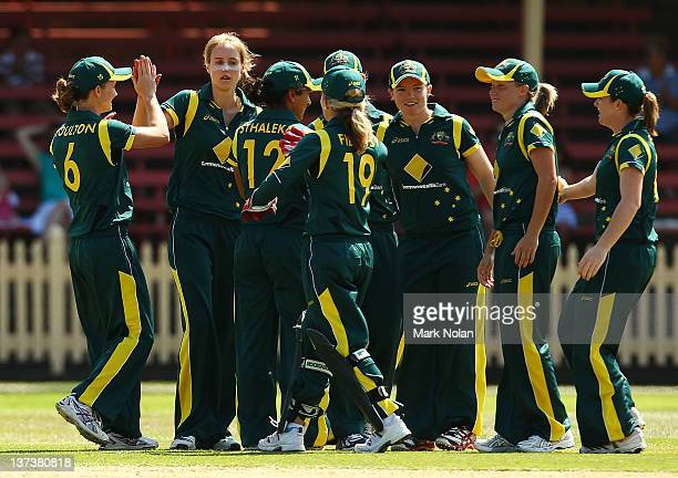 Ellyse Perry of Australia celebrates a wicket with team mates during the women's International Twenty20 match between the Australian Southern Stars...