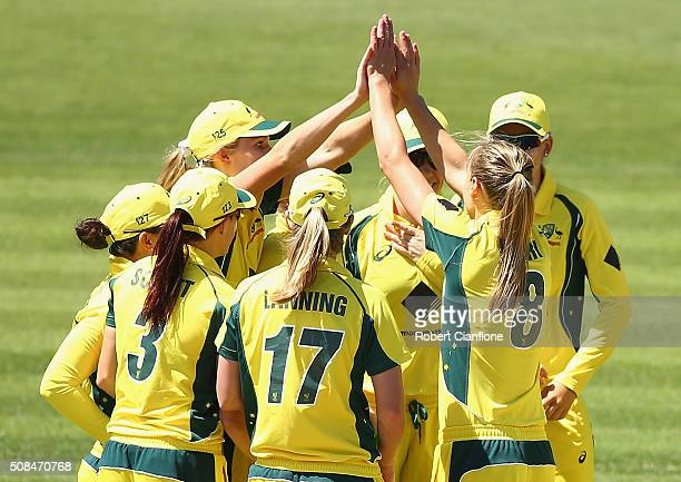 Ellyse Perry of Australia celebrates after taking the wicket of Murugesan Kamini of India during game two of the women's one day international series...