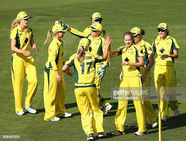Ellyse Perry of Australia celebrates after taking the wicket of Jhulan Goswami of India during game two of the women's one day international series...