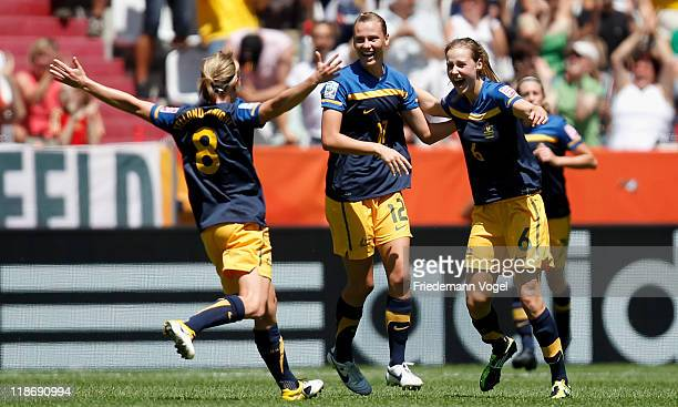 Ellyse Perry of Australia celebrates scoring the first goal with Emily van Egmond and Elise KellondKnight during the FIFA Women's World Cup 2011...