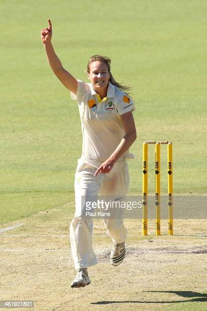 Ellyse Perry of Australia celebrates the dismissal of Kathryn Cross of England and her fifth wicket for the innings during day three of the Women's...