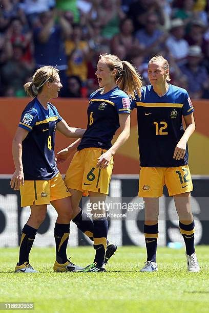 Ellyse Perry of Australia celebrates the first goal with Elise KellondKnight of Australia and Emily van Egmond of Australia during the FIFA Women's...