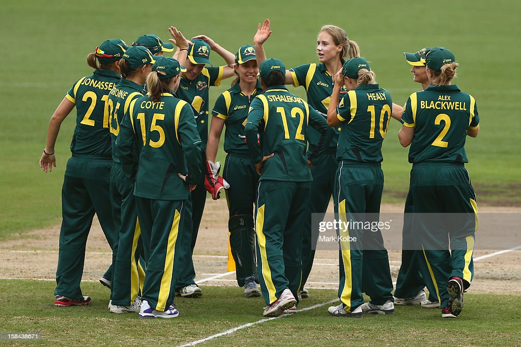 <a gi-track='captionPersonalityLinkClicked' href=/galleries/search?phrase=Ellyse+Perry&family=editorial&specificpeople=4414813 ng-click='$event.stopPropagation()'>Ellyse Perry</a> of Australia celebrates with her team after taking the wicket of Suzie Bates of New Zealand during game three of the One Day International series between the Australian Southern Stars and New Zealand at North Sydney Oval on December 17, 2012 in Sydney, Australia.