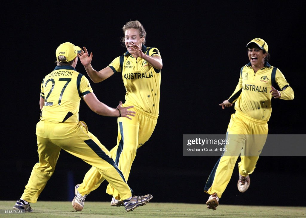 Ellyse Perry of Australia celebrates with Lisa Sthalekar and Jess Cameron after dismissing Stefanie Taylor of West Indies during the final between Australia and West Indies of the Women's World Cup India 2013 played at the Cricket Club of India ground on February 17, 2013 in Mumbai, India.