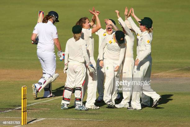 Ellyse Perry of Australia celebrates with team mates after dismissing Anya Shrubsole of England during day one of the Women's Ashes Test match...