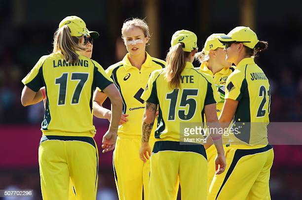 Ellyse Perry of Australia celebrates with team mates after taking the wicket of Harmanpreet Kaur of India during the International Twenty20 match...