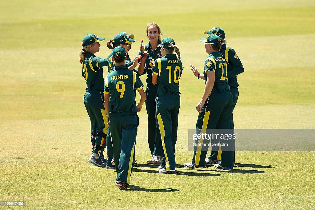 <a gi-track='captionPersonalityLinkClicked' href=/galleries/search?phrase=Ellyse+Perry&family=editorial&specificpeople=4414813 ng-click='$event.stopPropagation()'>Ellyse Perry</a> of Australia (C) celebrates with teammates after Suzie Bates of New Zealand was caught out by Jessica Cameron from the bowling of Perry during the Women's International Twenty20 match between the Australian Southern Stars and New Zealand at Junction Oval on January 24, 2013 in Melbourne, Australia.