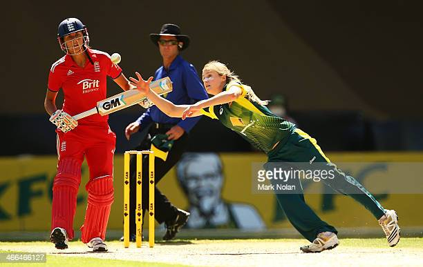Ellyse Perry of Australia dives to field off her own bowling during game three of the Women's International Twenty20 series between Australia and...