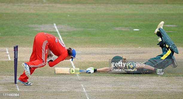 Ellyse Perry of Australia is run out by Sarah Taylor of England during the England Women and Australia Women Ashes Series 2nd NatWest ODI at The...