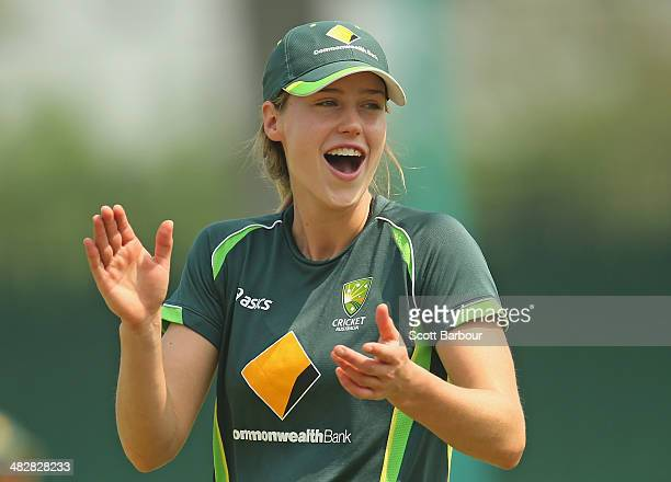 Ellyse Perry of Australia laughs during an Australia Women's nets session ahead of the ICC World Twenty20 Bangladesh 2014 Womens Final at Khan Shaheb...