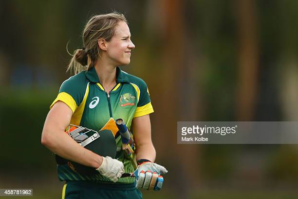 Ellyse Perry of Australia looks dejected as she leaves the field after being dismissed during game one of the women's One Day International series...
