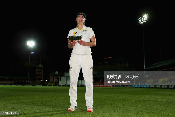 Ellyse Perry of Australia poses with her player of the match award during day four of the Women's Test match between Australia and England at North...