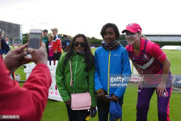 Ellyse Perry of Loughborough Lightning poses for a photograph with two fans after the Kia Super League 2017 match between Loughborough Lightning and...