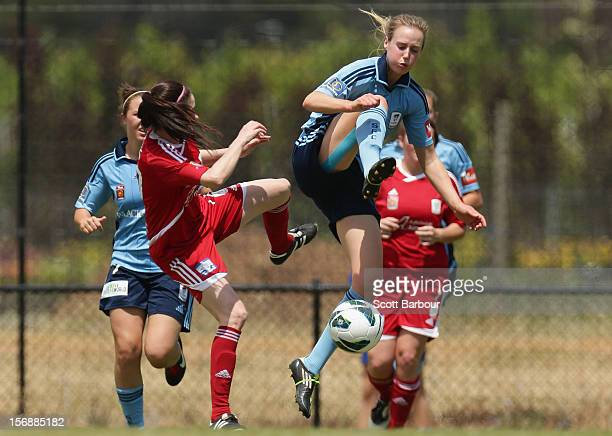 Ellyse Perry of Sydney FC and Laura Johns of United compete for the ball during the round six WLeague match between Adelaide United and Sydney FC at...