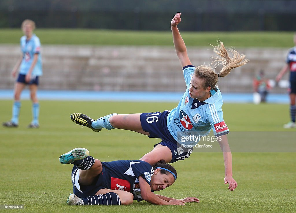 <a gi-track='captionPersonalityLinkClicked' href=/galleries/search?phrase=Ellyse+Perry&family=editorial&specificpeople=4414813 ng-click='$event.stopPropagation()'>Ellyse Perry</a> of Sydney FC is fouled by <a gi-track='captionPersonalityLinkClicked' href=/galleries/search?phrase=Lisa+De+Vanna&family=editorial&specificpeople=221148 ng-click='$event.stopPropagation()'>Lisa De Vanna</a> of the Victory during the round one W-League match between the Melbourne Victory and Sydney FC at Lakeside Stadium on November 10, 2013 in Melbourne, Australia.