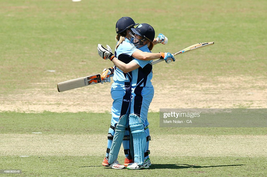 Ellyse Perry of the Breakers and team mate Alex Blackwell embrace after Perry scored a century century during the WNCL match between the ACT Meteors...