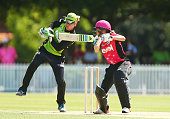 Ellyse Perry of the Sixers bats as Claire Koski of the Thunder keeps wicket during the Women's Big Bash League match between the Sydney Thunder and...