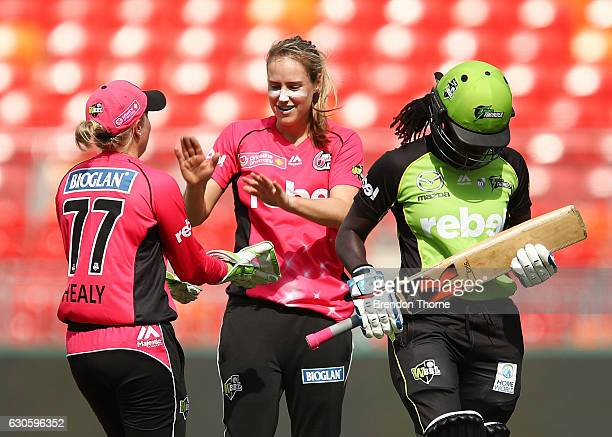 Ellyse Perry of the Sixers celebrates with team mate Alyssa Healy after claiming the wicket of Stafanie Taylor of the Thunder during the WBBL match...