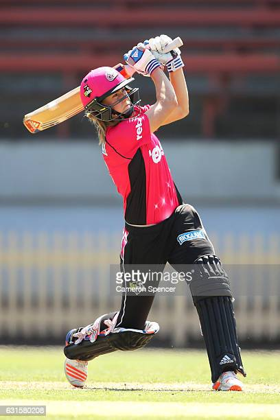 Ellyse Perry of the Sixers hits a six during the Women's Big Bash League match between the Hobart Hurricanes and the Sydney Sixers at North Sydney...