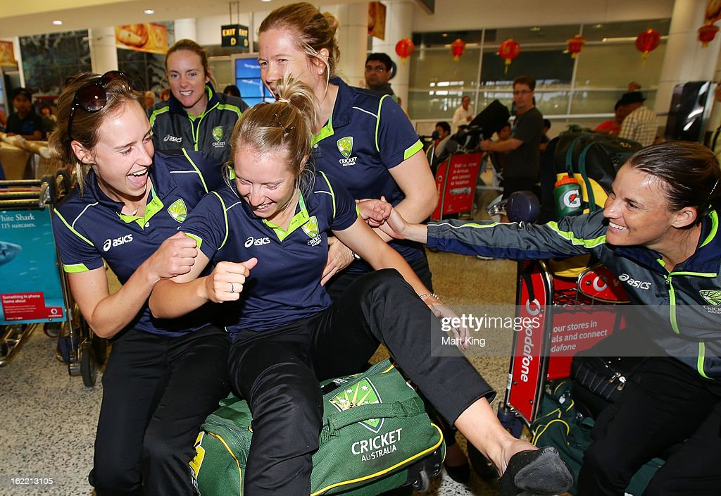 Ellyse Perry, Sarah Coyte, Alyssa Healy, Alex Blackwell and Erin Osborne of the Australian women's cricket team share a laugh after arriving home following their win in the 2013 World Cup at Sydney International Airport on February 21, 2013 in Sydney, Australia.