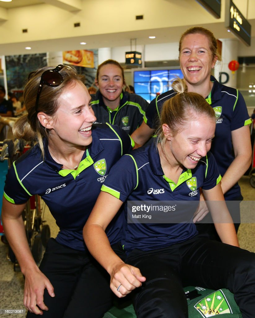 Ellyse Perry, Sarah Coyte, Alyssa Healy and Alex Blackwell of the Australian women's cricket team share a laugh after arriving home following their win in the 2013 World Cup at Sydney International Airport on February 21, 2013 in Sydney, Australia.