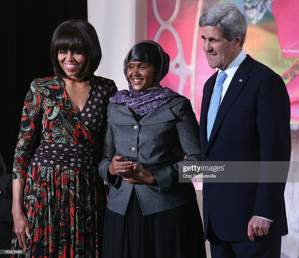 Elman Peace and Human Rights Centre Executive Director Fartuun Adan (C) of Somalia poses for photographs with U.S. Secretary of State John Kerry (R) and U.S. first lady Michelle Obama after receiving the International Women of Courage award at the State Department March 8, 2013 in Washington, DC. In celebration of the 102nd International Women's Day, the State Department honored nine women from around the world with the International Women of Courage Award, including the 23-year-old Indian woman known only as 'Nirbhaya,' who died from injuries she received after being gang raped by six men last December in Delhi.