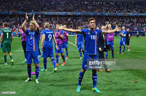 Elmar Bjarnason and Iceland players celebrate after the UEFA EURO 2016 round of 16 match between England and Iceland at Allianz Riviera Stadium on...
