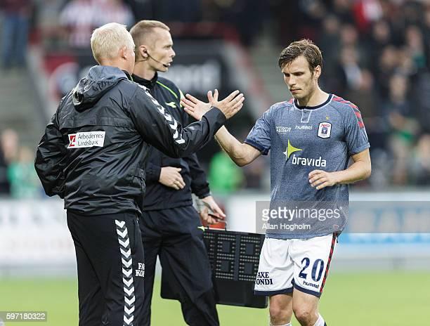 Elmar Bjarnason of AGF and Glen Riddersholm head coach of AGF in action during the Danish Alka Superliga match between AaB Aalborg and AGF Aarhus at...