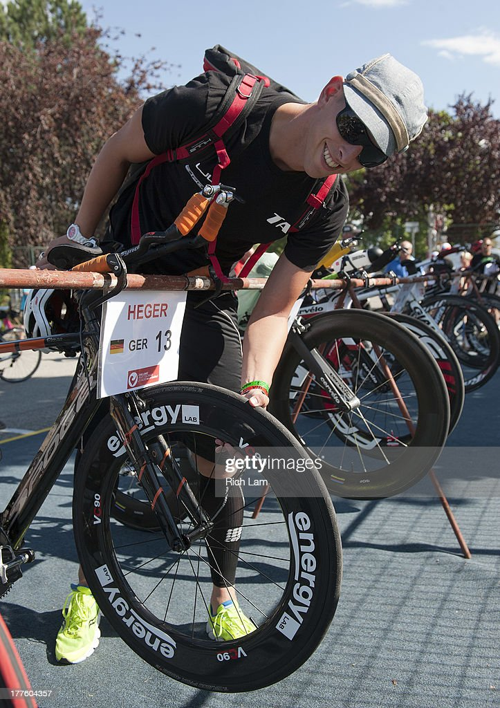 Elmar Heger of Germany poses for a photo while checking the tire on his bike during the Challenge Penticton Triathlon previews on August 24, 2013 in Penticton, British Columbia, Canada.