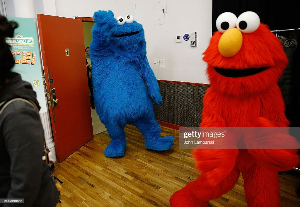 Elmo and the Cookie Monster Foundation attend Sesame Street Live Dance Class at Ripley Greer Studios on February 10, 2016 in New York City.