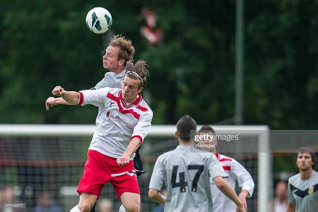Elmo Liefting of Vitesse, Take van Hardeveld of Valleivogels during the pre season friendly match between on June 20, 2013 at Sportpark de Bree West in Scherpenzeel , The Netherlands.