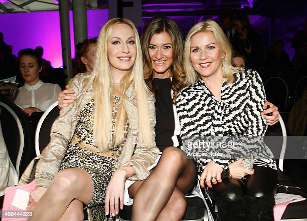 ElnaMargret zu Bentheim und Steinfurt Sandra Thier and Aleksandra Bechtel attend the Basler fashion show on February 1 2014 in Dusseldorf Germany