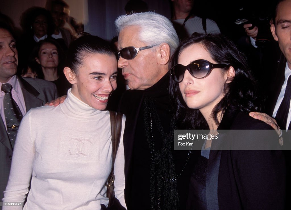 <a gi-track='captionPersonalityLinkClicked' href=/galleries/search?phrase=Elodie+Bouchez&family=editorial&specificpeople=228476 ng-click='$event.stopPropagation()'>Elodie Bouchez</a>, Karl Lagerfeld, <a gi-track='captionPersonalityLinkClicked' href=/galleries/search?phrase=Amira+Casar&family=editorial&specificpeople=239076 ng-click='$event.stopPropagation()'>Amira Casar</a>. during 2004 Spring-Summer Ready to Wear Paris Fashion Week - Chanel Front Row at Carousel du Louvre in Paris, France.
