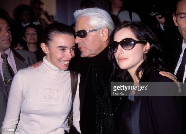 Elodie Bouchez Karl Lagerfeld Amira Casar during 2004 SpringSummer Ready to Wear Paris Fashion Week Chanel Front Row at Carousel du Louvre in Paris...