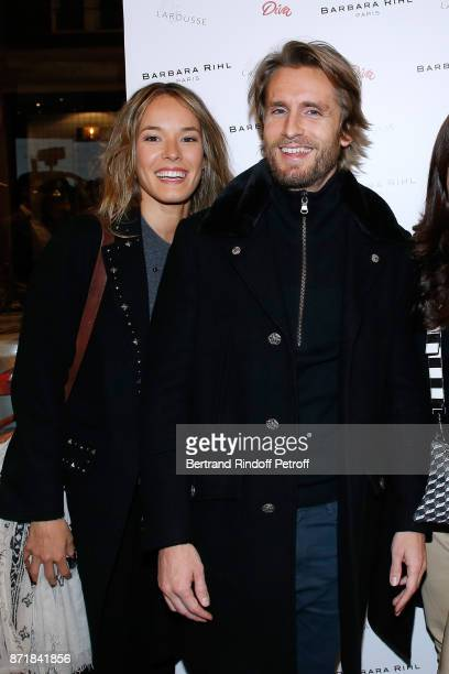 Elodie Fontan and Philippe Lacheau attend Reem Kherici signs her book 'Diva' at the Barbara Rihl Boutique on November 8 2017 in Paris France