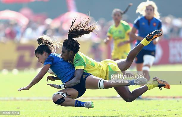 Elodie Guiglion of France is tackled by Ellia Green of Australia during the Emirates Dubai Rugby Sevens HSBC World Rugby Women's Sevens Series at The...