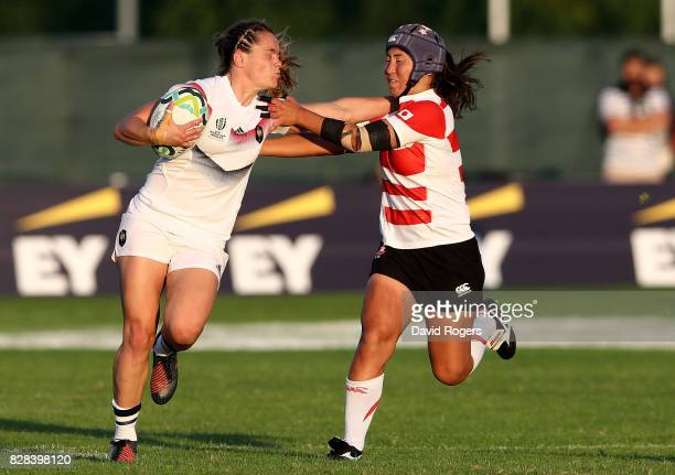 Elodie Poublan of France is tackled by Minori Yamamoto of Japan during the Women's Rugby World Cup 2017 match between France and Japan on August 9...