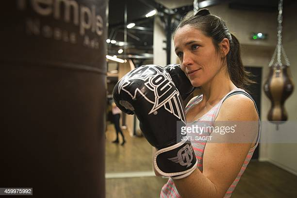 IOVENE Elodie practices during a women's boxing class on December 2 2014 in Paris AFP PHOTO JOEL SAGET