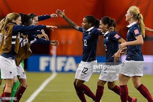 Elodie Thomis and Amel Majri of France celebrate Louisa Necib's goal with teammates during the 2015 FIFA Women's World Cup quarter final match at...