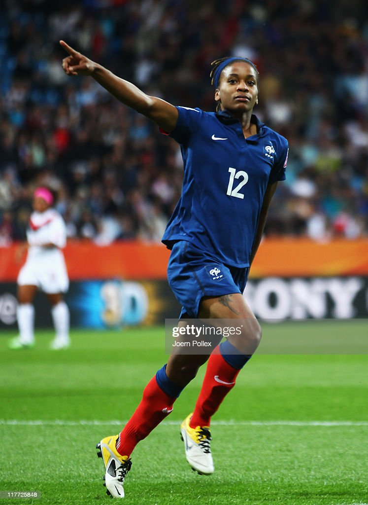 <a gi-track='captionPersonalityLinkClicked' href=/galleries/search?phrase=Elodie+Thomis&family=editorial&specificpeople=813220 ng-click='$event.stopPropagation()'>Elodie Thomis</a> of France celebrates after scoring her team's fourth goal during the FIFA Women's World Cup 2011 Group A match between Canada and France at Rewirpower Stadium on June 30, 2011 in Bochum, Germany.