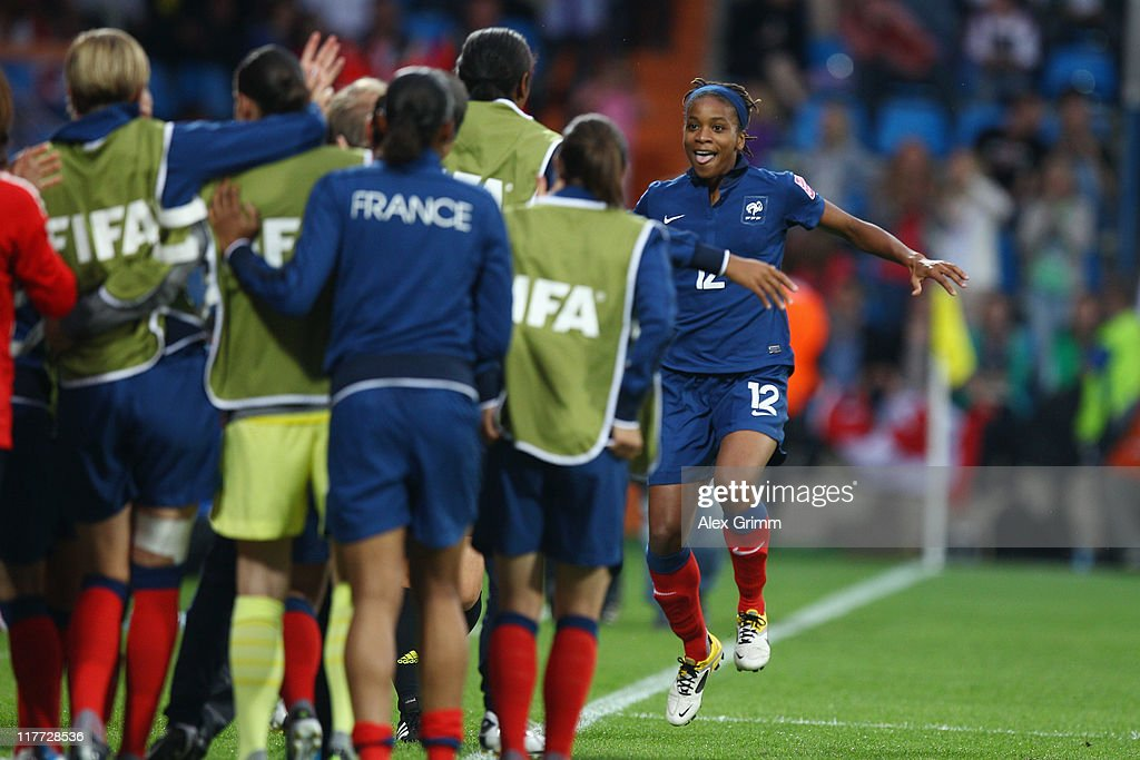 <a gi-track='captionPersonalityLinkClicked' href=/galleries/search?phrase=Elodie+Thomis&family=editorial&specificpeople=813220 ng-click='$event.stopPropagation()'>Elodie Thomis</a> of France celebrates her team's fourth goal with team mates during the FIFA Women's World Cup 2011 Group A match between Canada and France at the Fifa Womens World Cup Stadium on June 30, 2011 in Bochum, Germany.