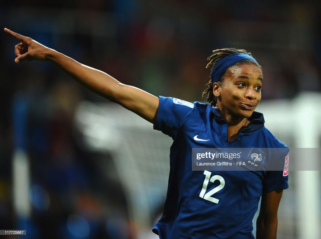 <a gi-track='captionPersonalityLinkClicked' href=/galleries/search?phrase=Elodie+Thomis&family=editorial&specificpeople=813220 ng-click='$event.stopPropagation()'>Elodie Thomis</a> of France celebrates scoring the third goal during the FIFA Women's World Cup 2011 Group A match between Canada and France at the Fifa Womens World Cup Stadium on June 30, 2011 in Bochum, Germany.