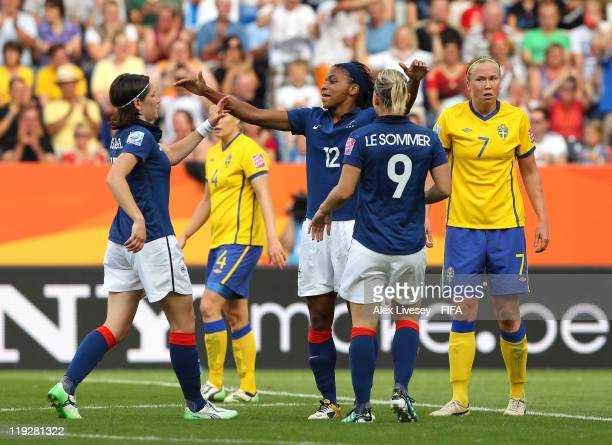 Elodie Thomis of France celebrates with Eugenie Le Sommer and Elise Bussaglia after scoring her goal during the FIFA Women's World Cup 3rd Place...