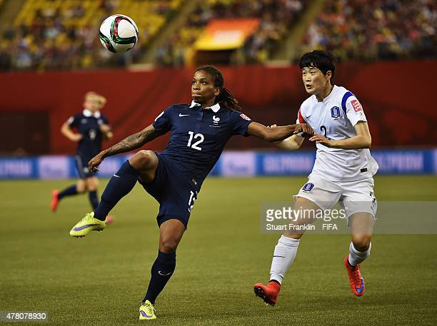 Elodie Thomis of France is challenged by Eunmi Lee of Korea during the FIFA Womens's World Cup round of 16 match between France and Korea at Olympic...