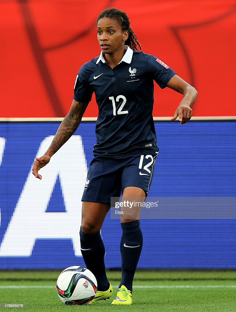 <a gi-track='captionPersonalityLinkClicked' href=/galleries/search?phrase=Elodie+Thomis&family=editorial&specificpeople=813220 ng-click='$event.stopPropagation()'>Elodie Thomis</a> #12 of France takes the ball in the first half against England during the FIFA Women's World Cup 2015 Group F match at Moncton Stadium on June 9, 2015 in Moncton, Canada.