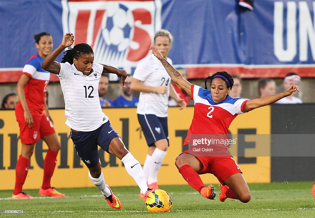 Elodie Thomis #12 of France, tries to keep the ball from Sydney Leroux #2 of the United States during a game between France and the United States June 19, 2014 at Rentschler Field in East Hartford, Connecticut.