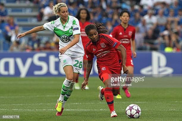 Elodie Thomis of Olympique Lyonnais competes for the ball with Lena Goessling of VfL Wolfsburg during the UEFA Women's Champions League Final VfL...