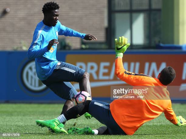 Eloge Koffi Yao Guy is challenged by Juan Pablo Carrizo during the FC Internazionale training session at the club's training ground Suning Training...