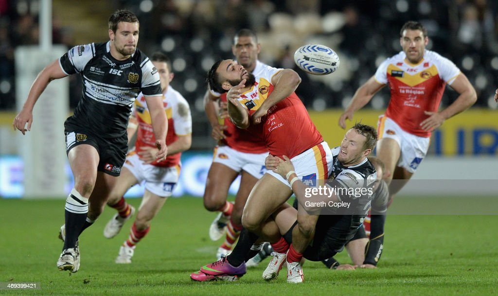 Eloi Pelissier of Catalan Dragons offloads underpressure from Jordan Rankin of Hull FC during the Super League match between Hull FC and Catalans...