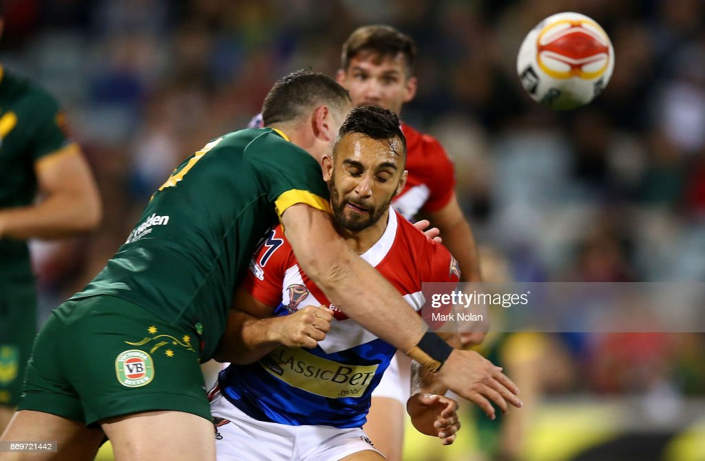 Eloi Pelissier of France is tackled late after passing the ball during the 2017 Rugby League World Cup match between Australian Kangaroos and France at Canberra Stadium on November 3, 2017 in Canberra, Australia.
